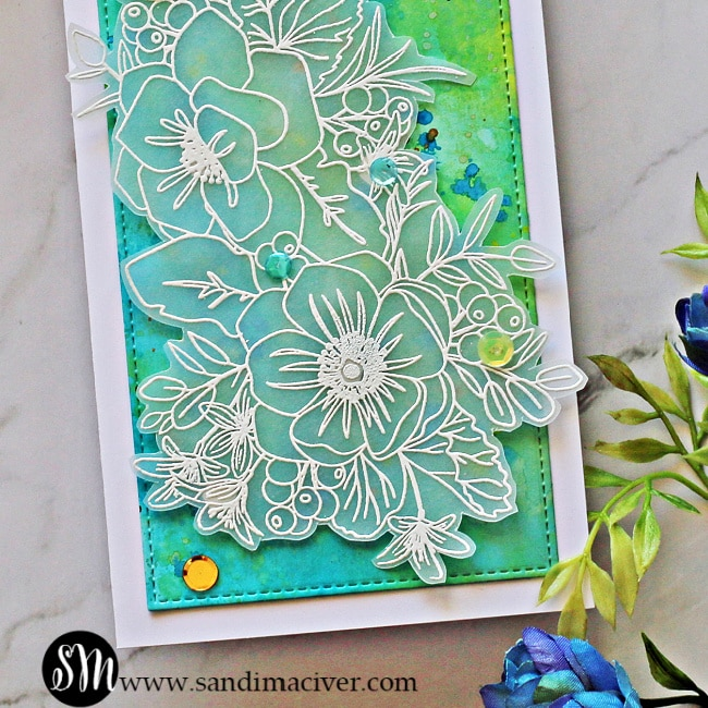 picture of the Simon Says Stamp Friendly Flowers stamp white embossed on Vellum