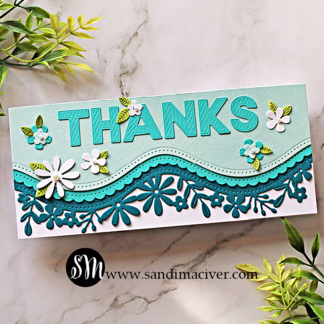 picture of a slimline blue gradient card created with the Spellbinders Large Die of the Month Kit