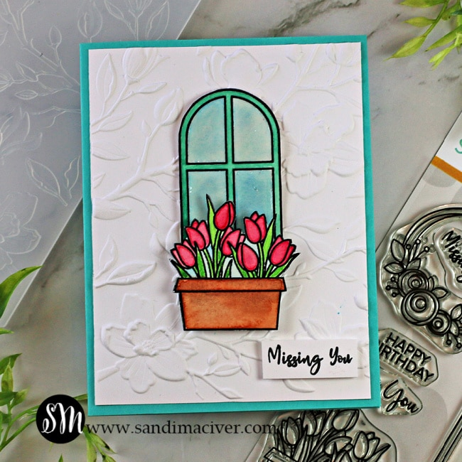 a hand made greeting card with a window and flower box and a background embossed with the Magnolia Branches embossing folder from Simon Says Stamp