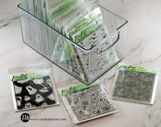 rubber stamps stored in fridge bins for my cardmaking studio